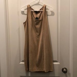 Tan body con mini dress with offset chest swoop